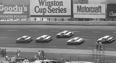 Number 1 Buddy Baker leads #33 Harry Gant, #11 Darrell Waltrip, and #50 Bruce Hill during the World 600.