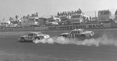 Number 11 Darrell Waltrip prepares to pass a smoking #88 Bobby Allison in the Oct. 3 Holly Farms 400