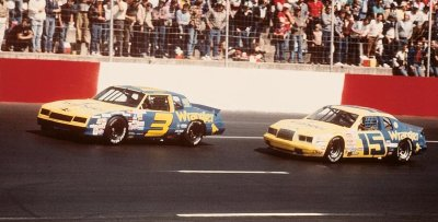 The Wrangler Jeans company sponsored Earnhardt's #3 Chevrolet and Moore's #15 Ford.