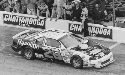 Davey Allison's #28 Ford skidded into the protective dirt embankment at the Feb. 19 Daytona 500.