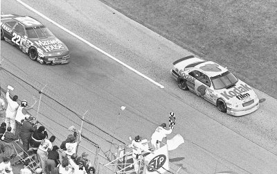 Ernie Irvan crosses under the checkered flag to win the Daytona 500.
