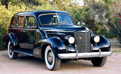The 1938 Cadillac Series 90 V-16 limousine, part of the 1938-1940 Cadillac Series 90 Sixteen line of collectible cars.
