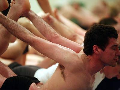 Students practice Bikram yoga at a studio in London.