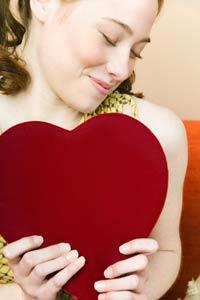 blushing girl holding heart