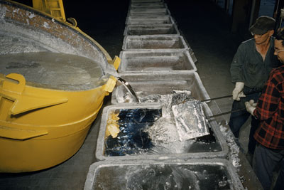 Molten aluminum in pots ready to be poured