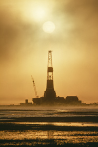 Oil rig on Prudhoe Bay at sunset