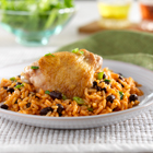 Rice and beans cooked with tomato sauce and seasoned chicken for a one skillet dish