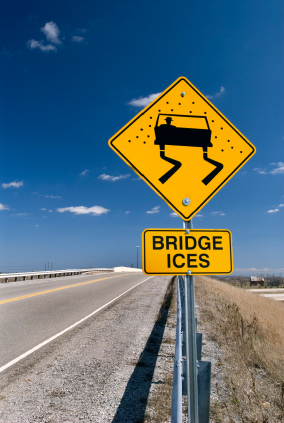 why does the road surface of a bridge freeze before a regular road