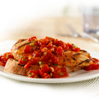 Chicken, marinated in balsamic vinaigrette with tomato paste, is grilled, placed on toasted bread and topped with a diced tomato mixture for a bruschetta-inspired entree