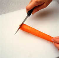 carrot being sliced
