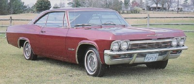 The 1965 Chevrolet Impala SS and other full-size cars got rounded bodysides, a higher beltline, and an aggressive rear-quarter bulge that year.