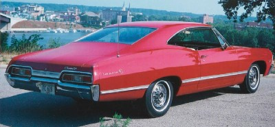 The 1967 Chevrolet Impala featured a roofline that sloped into the decklid.