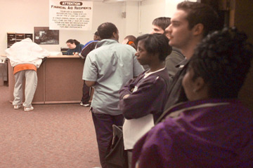 Students waiting in line at financial aid office.