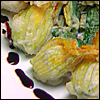 Deep-Fried Zucchini Flowers with Fontina and Basil, Served with a Blackberry and Balsamic Reduction