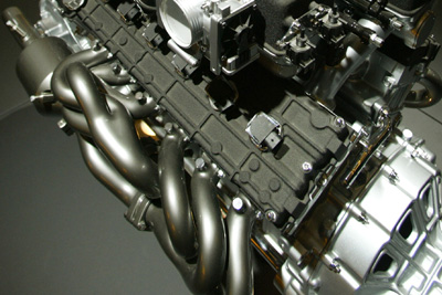 How do exhaust headers work to improve engine performance