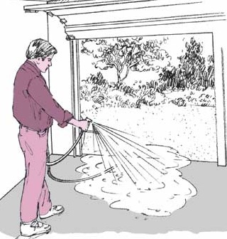 Cleaning a garage floor can be done with a simple garden hose.