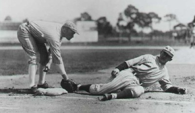 Frankie Frisch slides into first under Jack Bentley's tag in a 1925 spring game between Giant's regulars and yannigans.