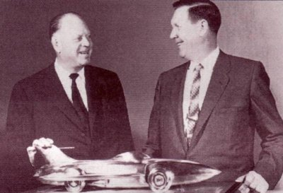 GM's Harley Earl and NASCAR's Bill France with a Firebird-topped NASCAR trophy