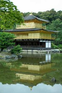 The Golden Pavilion is reflected in a tranquil pond, a planned effect, so that the reflection produces a second pavilion.