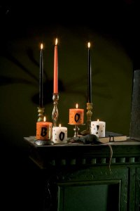 Create a spooky scene with these ghoulish candles.