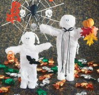Use clothespins and cheesecloth to create these funny Junior and his Mummy Halloween decorations.