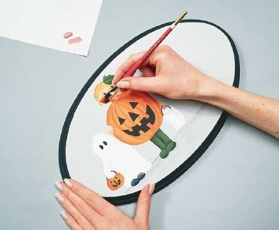 Add details to the painted characters on your Halloween welcome sign to bring this Halloween decoration to life.