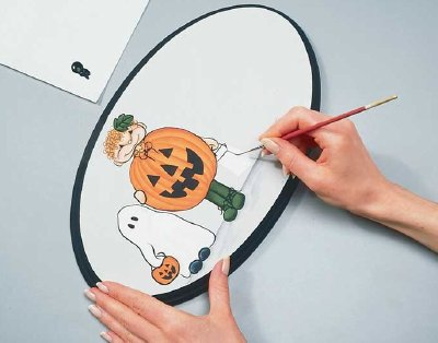 After painting the characters on your Halloween welcome sign, add a message to this Halloween decoration.