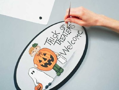 Put the final touches on your Halloween welcome sign, and then this Halloween decoration is ready to go.