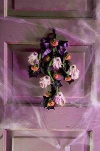 Welcome guests in style with this glitzy door decoration.