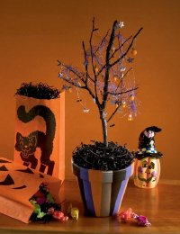 You can turn an ordinary tree branch into a spooky Halloween tree.