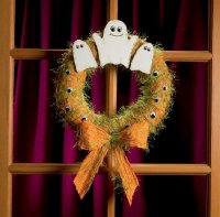 This lighthearted Halloween wreath welcomes trick-or-treaters.