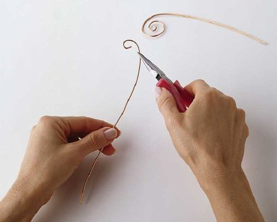 Carefully curl the wire into a swirl.