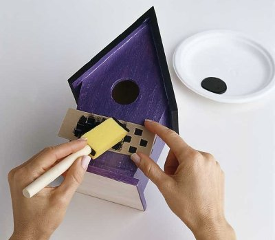 Use the stencil to paint a checkerboard pattern onto the middle of the house.