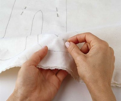 To keep the muslin layers from shifting, pin them.