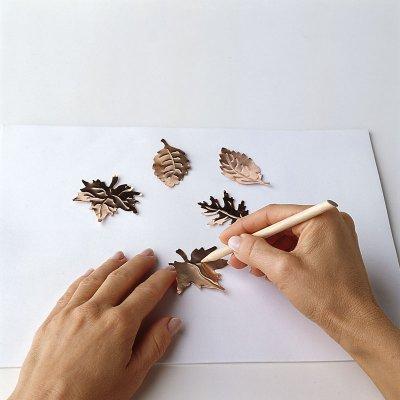 Emboss leaf veins using a blunt-tip stylus.