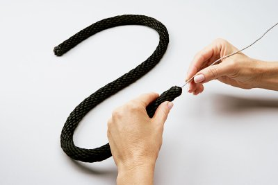 Push the 14-gauge wire into the black rope.