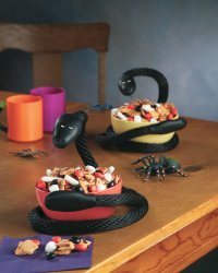 Make your guests recoil in horror with this slinky snake decoration.