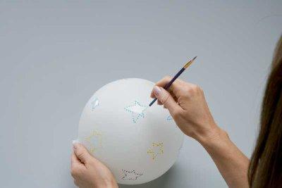 Using the small paintbrush, paint around each star.