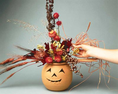 With the finishing touches in place, this floral jack-'o-lantern Halloween decoration is a resounding success.