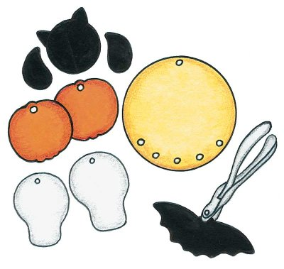 Use a paper punch to make holes to attach your Halloween shapes to the Halloween mobile you're creating.