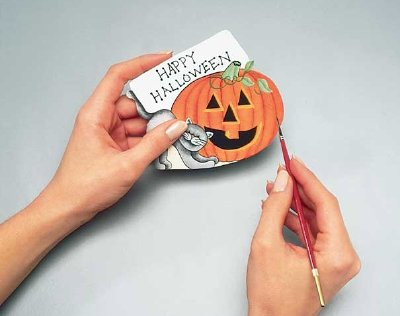 Use a liner brush to add the final touches and a Halloween message to your Halloween wreath.