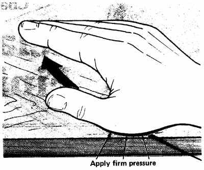 Diagram of oil being applied by hand to wooden furniture.