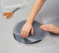 Use fingertips to press paper firmly around bottom edge of the baking pan and make a crease.