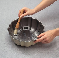 A pastry brush works well for greasing all the creases and curves of a Bundt® pan.
