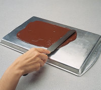 A long, flat metal spatula makes it easier to spread the chocolate in an even layer.