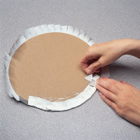 Wrap the foil around the edges of our cardboard circle.