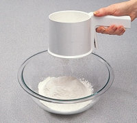 Sifting dry ingredients helps distribute them throughout the cake batter.