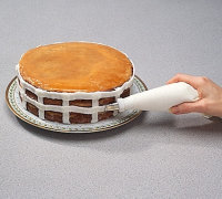 # Use left hand to rotate cake plate as you pipe on horizontal strips.