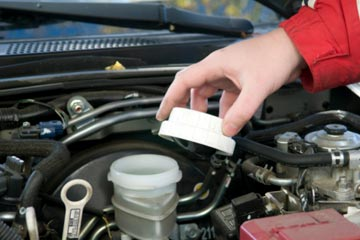 Locate the brake fluid reservoir and unscrew the cap.