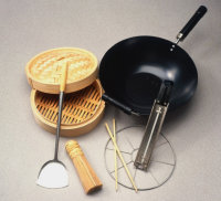 Clockwise from top left: bamboo steamer, wok, deep-fry thermometer, wire steamer rack, chopsticks, bamboo brush, and Chinese spatula.